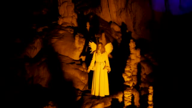 actors dressed as an angel and musician perform live biblical scene in postojna cave on december 25 2018 in postojna slovenia the annual nativity... - december stock videos & royalty-free footage