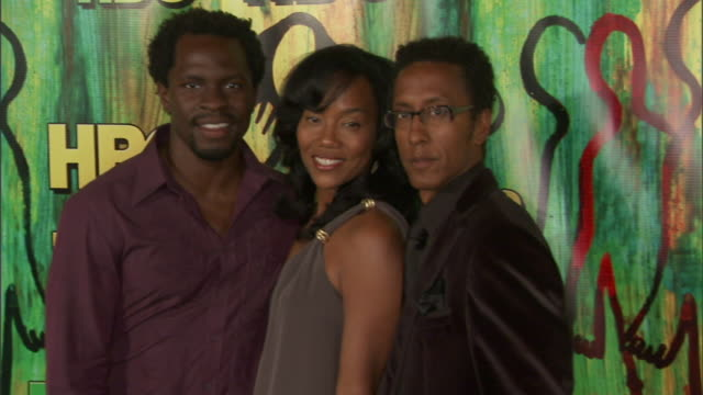 HD Actors Gbenga Akinnagbe Sonja Sohn Andre Royo posing together on red carpet at Pacific Design Center for camera press