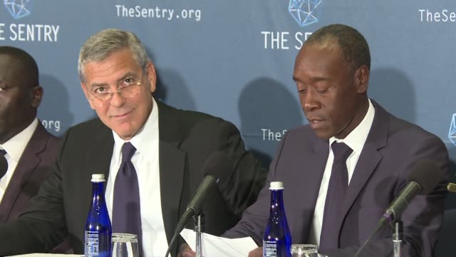 Actors George Clooney and Don Cheadle unveil report about how South Sudan's leaders have grown rich thanks to civil war