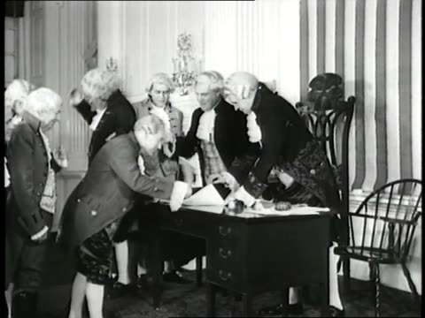 actors impersonating the founding fathers reenact the signing of the declaration of independence. - unabhängigkeit stock-videos und b-roll-filmmaterial