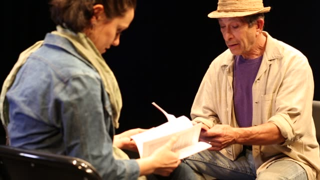 actors in theater rehearsing