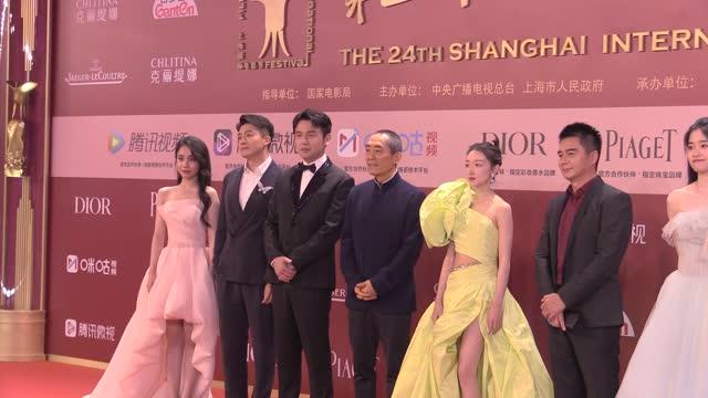 actors lin boyang, sun yizhou, lei jiayin, director zhang yimou, zhou dongyu, xu yajun and chen tong attend opening ceremony of the 24th shanghai... - celeb stock videos & royalty-free footage