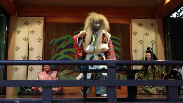 ms actors on stage in folk kagura (shinto theatrical dance) at takadanobaba obon festival / tokyo japan - 演劇点の映像素材/bロール