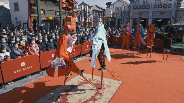 actors performance stilts in spring festival temple fair on february 16 in xi'an, shaanxi province of china. - cultures stock videos & royalty-free footage