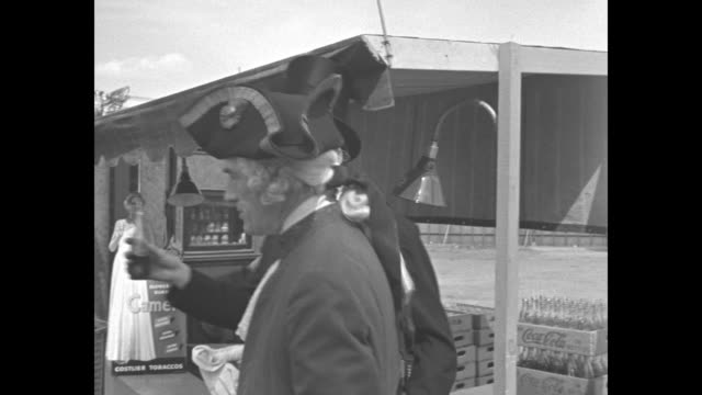 Actors portraying Abe Lincoln and George Washington enjoy a Coke and ice cream at vendor's stand at the New York World's Fair / VS 'Teddy Roosevelt'...