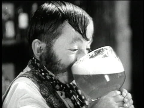 1938 montage actors singing in a saloon while customer drinks a huge beer in the film 'terror of tiny town' / united states - beer alcohol stock videos and b-roll footage
