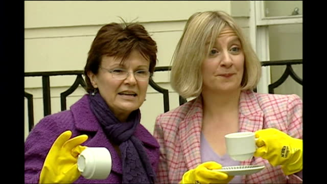 actors victoria wood and julie walters pose for photos with dish washing gloves and tea cups for to promote 'acorn antiques: the musical!' based on... - soap opera stock videos & royalty-free footage