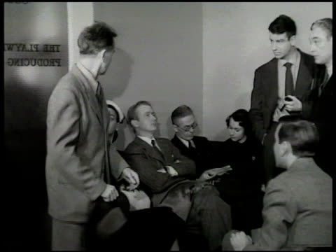 stockvideo's en b-roll-footage met actors waiting in the playwrights producing co waiting room standing bg holding pipe is young walter matthau large woman exiting office - 1949