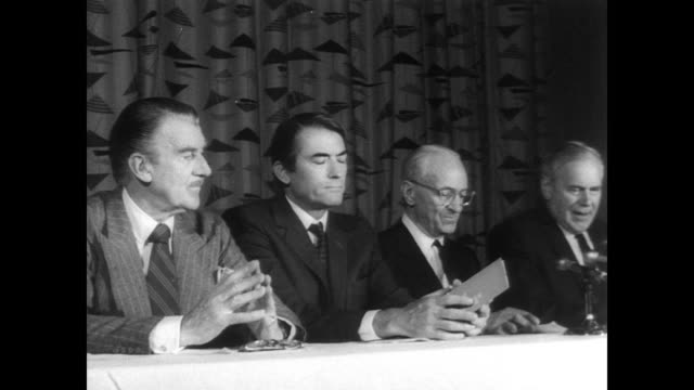 actors walter pidgeon and gregory peck sit with jules stein and george bagnall at long white table on a stage / press film announcement of movie for... - gregory peck stock videos and b-roll footage