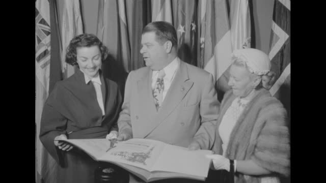 actress allyn mclerie stands with la city councilman don a allen and his wife margaret as they look at a proclamation issued by the council... - wax stock videos & royalty-free footage