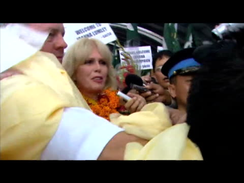 actress and gurkha campaigner joanna lumley is surrounded by well wishers and press at tribhuvan international airport katmandu 27 july 2009 - joanna lumley stock videos & royalty-free footage