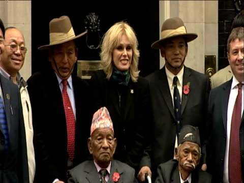 actress and human rights campaigner joanna lumley poses for press outside 10 downing street alongside gurkha veterans london 21 may 2009 - joanna lumley stock videos & royalty-free footage