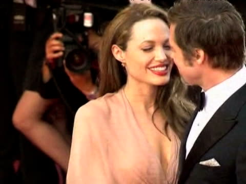 actress angelina jolie and husband brad pitt pose for press at 61st cannes film festival france; 14 may 2009 - brad pitt actor stock videos & royalty-free footage