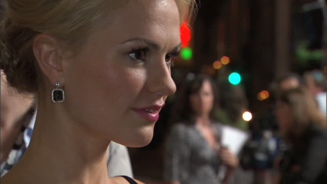 Actress Anna Paquin on red carpet outside Cinerama Dome talking to press