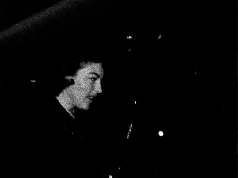 vídeos de stock e filmes b-roll de actress ava gardner arrives to open queen victoria hospital charity fair; england: london: heathrow airport: ext at night actress ava gardner from... - ava gardner