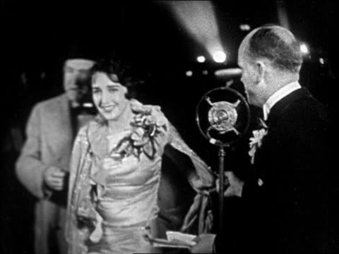 "actress bebe daniels talking to announcer at ""interference"" premiere / newsreel - 1928 stock videos & royalty-free footage"