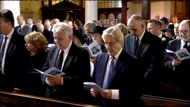 actress betty driver funeral; england: manchester: at ann's church: int congregation singing hymn at funeral of coronation street actress betty... - soap opera stock videos & royalty-free footage