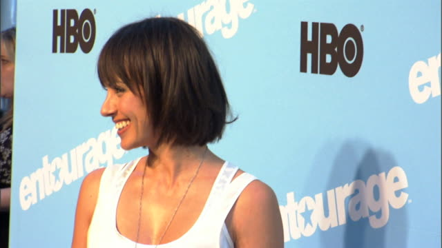 HD Actress Constance Zimmer on carpet outside Ziegfeld Theater posing for press photographs