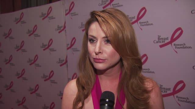 actress diane neal excited to be out wearing pink. thinks it is a great cause and she's happy to support it. talks about the money that they raise... - hot pink stock videos & royalty-free footage