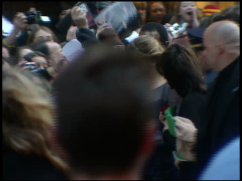 actress emma watson on street w/ group security signing autographs for fans behind barricades - 2005 stock videos & royalty-free footage