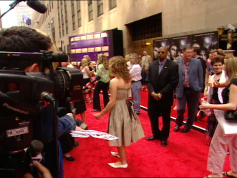actress emma watson standing on red carpet near radio city music hall talking to various press - radio city music hall stock videos and b-roll footage