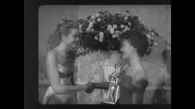 ms actress grace kelly presents the audience award for best actor to actress natalie wood who accepts it on behalf of the late james dean / ws... - grace kelly actress stock videos and b-roll footage