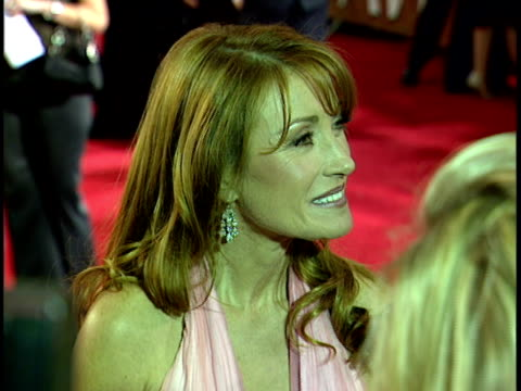 Actress Jane Seymour on crowded red carpet talking to press