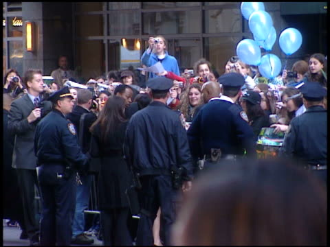 actress katie leung standing on street w/ group, security, nypd officers, signing autographs for fans behind barricade on street. - barricade stock videos & royalty-free footage