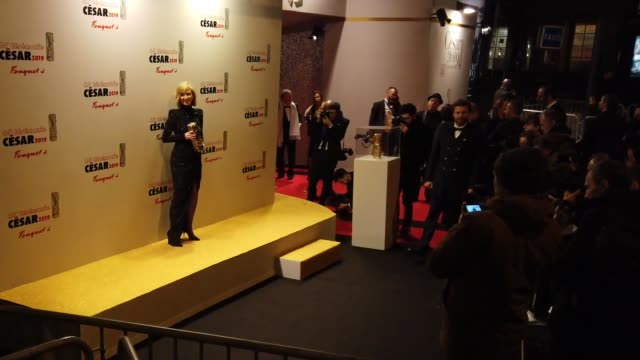 vidéos et rushes de actress lea drucker, winner of the award for best actress for 'jusqu'a la garde', is seen outside the dinner at the fouquet's, after the cesar... - cesar