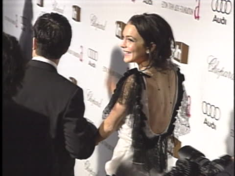 actress lindsay lohan smiles and waves as she arrives on the red carpet for the 2006 vanity fair party. - vanity fair stock videos & royalty-free footage