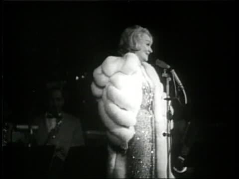 vidéos et rushes de actress marlene dietrich sings on stage. - 1960