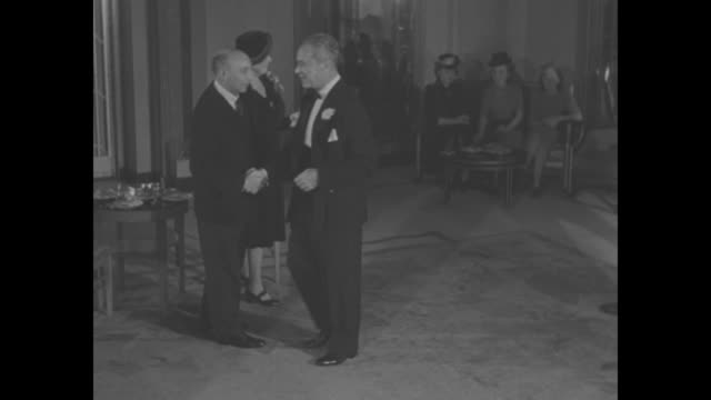 actress Martha Scott and William Eythe are announced and they stride across lobby to meet Mr and Mrs Reginald Bromhead / movie producer Walter Wanger...