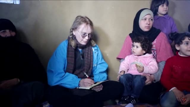 us actress mia farrow a unicef goodwill ambassador visits syrian refugees in baalbek lebanon in the bekaa valley as part of a two day visit to the... - mia farrow stock videos & royalty-free footage