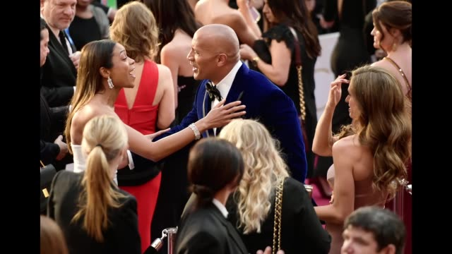 Actress Naomie Harris actor Dwayne Johnson and Lauren Hashian attend the 89th Annual Academy Awards at Hollywood Highland Center on February 26 2017...