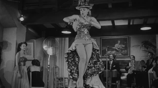 vídeos de stock, filmes e b-roll de actress ninon sevilla dancing and singing caceza hinchada in portuguese on a bar in rio de janeiro. - arts culture and entertainment