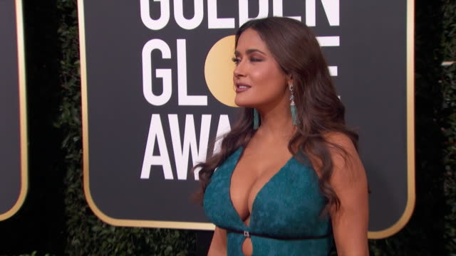 actress salma hayek poses on the red carpet at the 2020 golden globe awards. - golden globe awards stock-videos und b-roll-filmmaterial