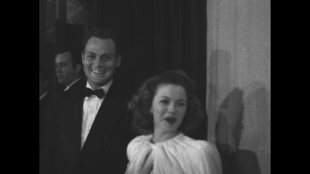 actress shirley temple and her husband, actor john agar, smile for the camera as they attend the 19th academy awards at the shrine auditorium - academy awards video stock e b–roll