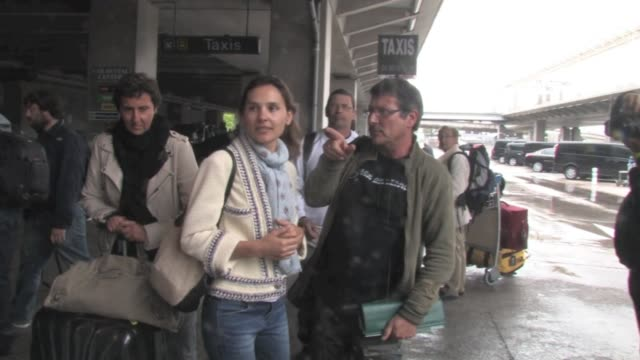 Actress Virginie Ledoyen makes a kind arrival at Nice airport so does director Michel Hazanavicius