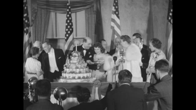 actresses deanna durbin maureen o'hara and kay aldridge sit on floor with first lady eleanor roosevelt and carol ann priester daughter of wallace... - waldorf astoria stock videos and b-roll footage