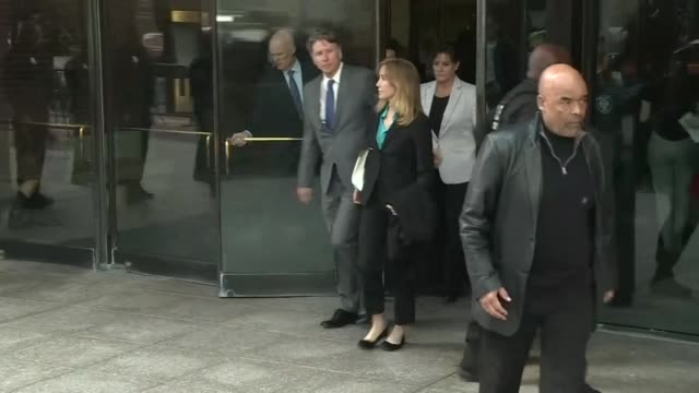 actresses felicity huffman and lori loughlin leave john joseph moakley courthouse in boston after a hearing on felony charges that they allegedly... - court hearing stock videos and b-roll footage