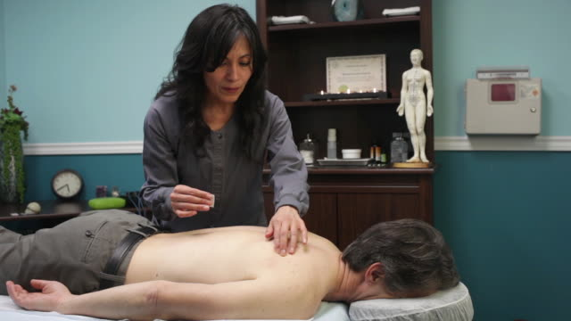 acupuncture treatment for shoulder pain - acupuncture stock videos and b-roll footage