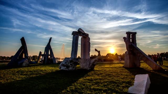 ada ciganlija stonehenge sunset time lapse, belgrade, serbia - gravestone stock videos & royalty-free footage