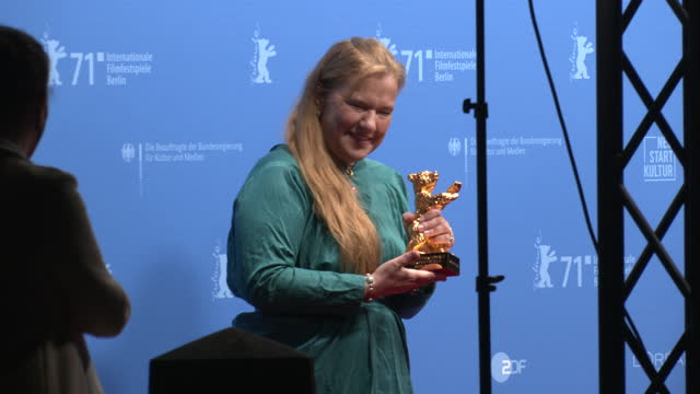 """ada solomon, winner of the golden bear for best film for their movie """"babardeală cu bucluc sau porno balamuc"""" poses with their trophy during a... - celeb stock videos & royalty-free footage"""