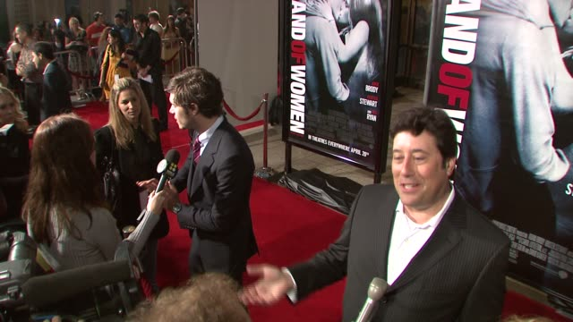 adam brody and david kanter producer at the 'in the land of women' los angeles premiere at arclight cinemas in hollywood california on april 16 2007 - adam brody stock videos & royalty-free footage
