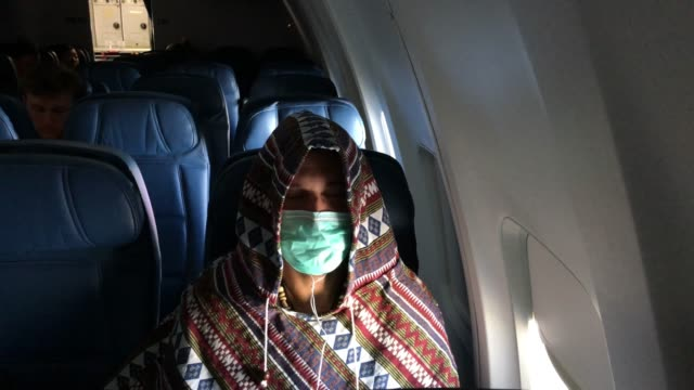 adam carver wears a mask to protect against coronavirus while on a nearly empty delta flight from seattle-tacoma international airport o jfk on march... - washington state stock videos & royalty-free footage