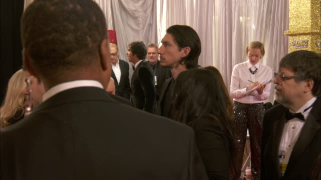 Adam Driver moving slowly with crowd down the red carpet at the Beverly Hilton Hotel
