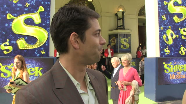 Adam Garcia on the atmosphere how the cast must be feeling being a Shrek fan future projects at the Shrek The Musical Press Night at London England