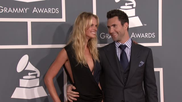 Adam Levine and Anne V at 54th Annual GRAMMY Awards Arrivals on 2/12/12 in Los Angeles CA