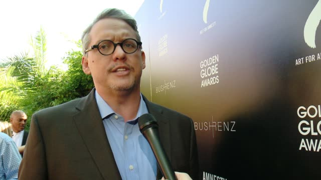 vídeos de stock e filmes b-roll de interview adam mckay on how it feels to be honored here today at art for amnesty's pregolden globes recognition brunch in los angeles ca - prémio globo de ouro