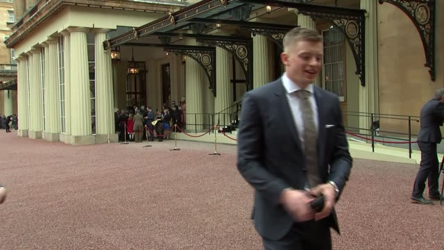 Adam Peaty and Justin Rose investiture ENGLAND London Buckingham Palace EXT Adam Peaty photocall holding medal / Justin Rose photocall with family...